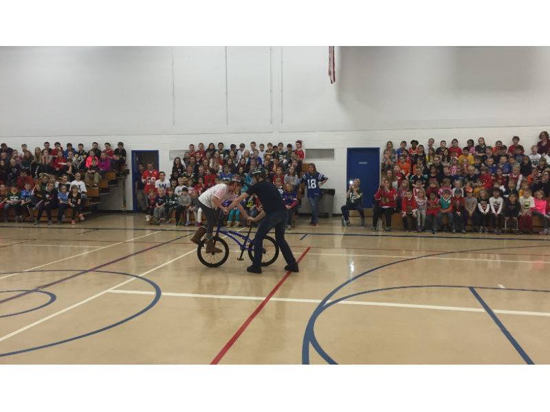 Matt Wilhelm teaching a student a trick during the show at Bethany Lutheran School in Naperville.