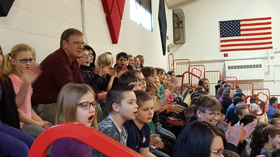Erie Elementary students cheering during the school assembly.