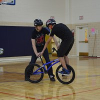 Matt Wilhelm teaching a trick to a Jr. High student.