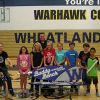 Matt Wilhelm posing with students after his school assembly at Wheatland Center School