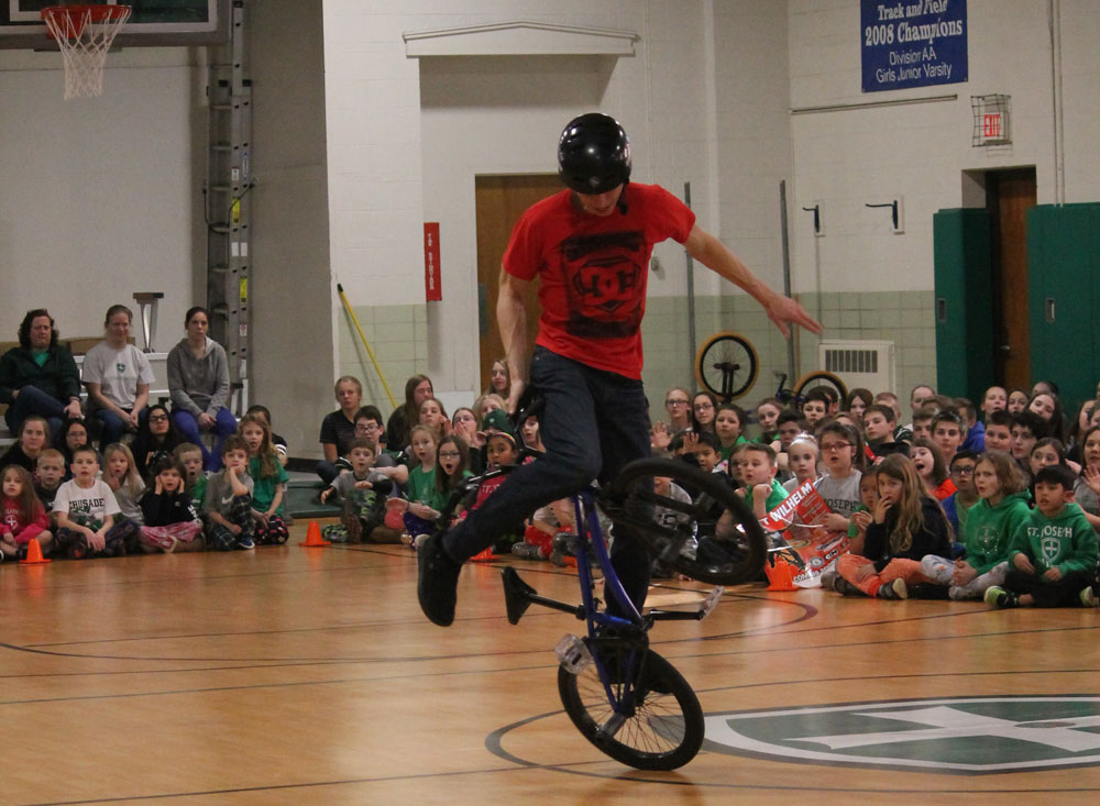 Matt Wilhelm performing a trick at St. Joseph Catholic School during Catholic Schools Week.
