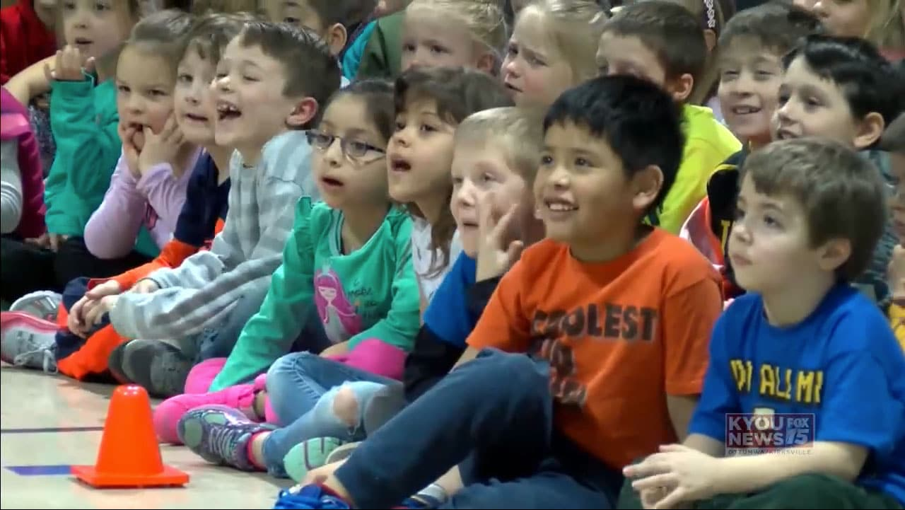Students watching Matt Wilhelm's anti-bullying school assembly in Ottumwa, Iowa.